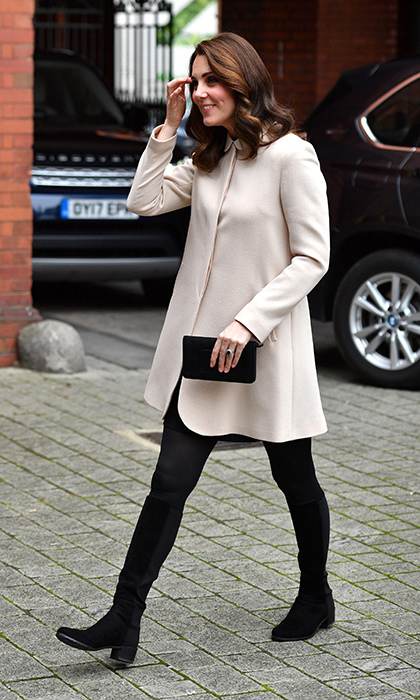 <p>The Duchess of Cambridge wore a £600 cream coat by Goat during a visit to Hornsey Road Children's Centre.</p>