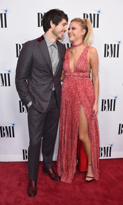 Kelsea Ballerini had the perfect accessory to her Amur gown, her fiancé Morgan Evans. The two stepped out in style to the BMI Country Awards prior to the CMAs in Nashville on November 7.