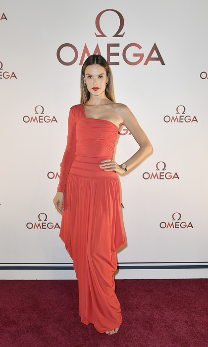 Alessandra Ambrosio wore a draped Antonio Berardi gown to the Omega Aqua Terra Collection launch party in Miami. The <em>Daddy's Home 2</em> actress opted for a sleek do and a red lip to finish her look.