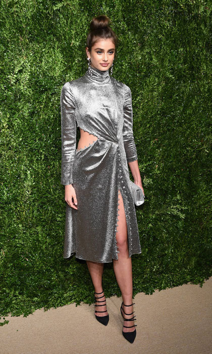 Taylor Hill's Prabal Gurung dress featured not one but two slits. The supermodel opted to wear her hair in a top knot to complement the high neck for the CFDA/Vogue Fashion Fund Awards. 