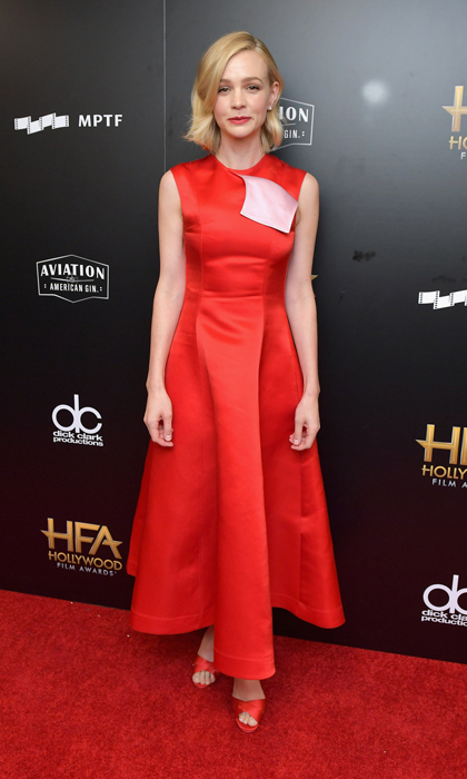 Carey Mulligan wore a red satin Calvin Klein dress with matching scarlet sandals to the Hollywood Film Awards in Beverly Hills. The mom-of-two wore an extreme part and simple makeup to complement the bright hue.