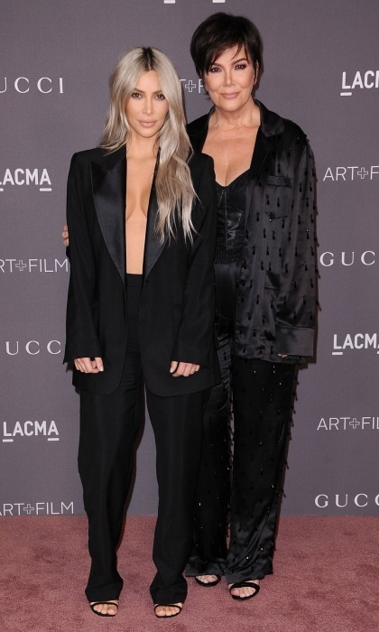 Meanwhile, Melanie's good friend Kris Jenner and her daughter Kim Kardashian went a bit more minimal for the LACMA Art + Film Gala. The Keeping Up with the Kardashians star showed some skin in an oversized black blazer and trousers by Tom Ford for Gucci. Her momager, who was celebrating her birthday weekend, also wore a black satin suit.