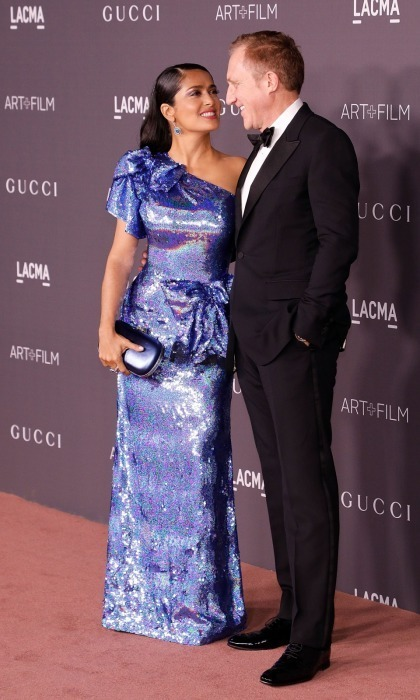 Sparkling and in love! Salma Hayek and her husband François-Henri Pinault couldn't keep their eyes off each other as they walked the star-studded carpet. The 51-year-old actress showcased her incredible hourglass figure in a single-sleeved glittering sapphire-sequin dress by Gucci. The Mexican-American star had VIP access to the Italian luxury designer, which sponsored the bash, thanks to her husband whose company Kering owns the brand.