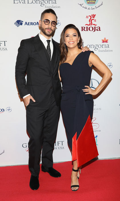 Eva Longoria was back in heels after suffering an injury while on vacation in Spain. After sporting a medical boot, the actress wore heeled sandals with her navy and red dress to the Global Gift Gala in Mexico City. 