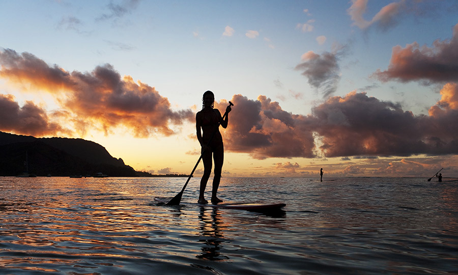 <h4>EXPLORE</h4><p>If you're a watersports fan, take advantage of the tremendous waves at Pine Trees beach at Hanalei Bay in the winter, or seek out its calmer waters, ideal for paddleboarding. To appreciate the island's rugged beauty, walking tracks are a good place to start. Take the Kalalau Trail, where you'll cross towering sea cliffs and lush valleys, stopping to bathe in crystalline streams and waterfalls.</p>
