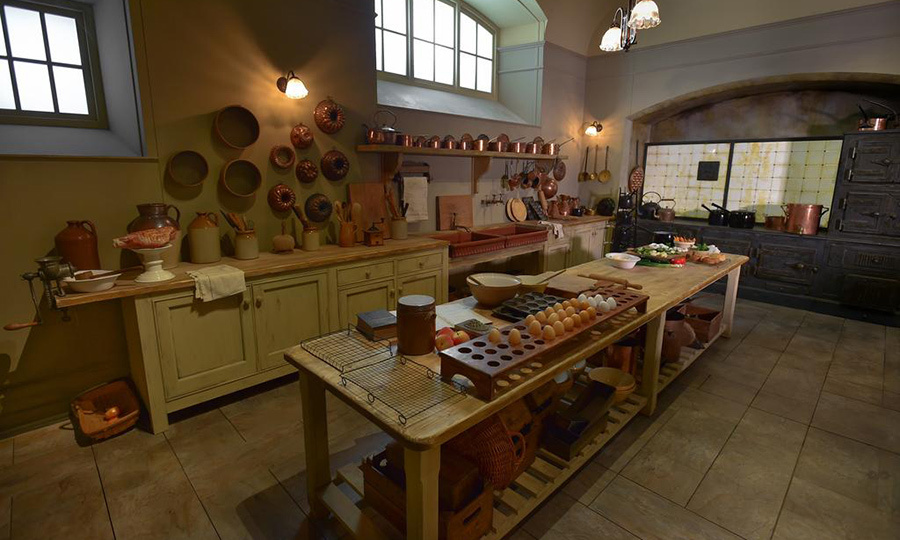<p>The kitchen has just as much character in the exhibit as in the show, down to the food items placed on the tables.