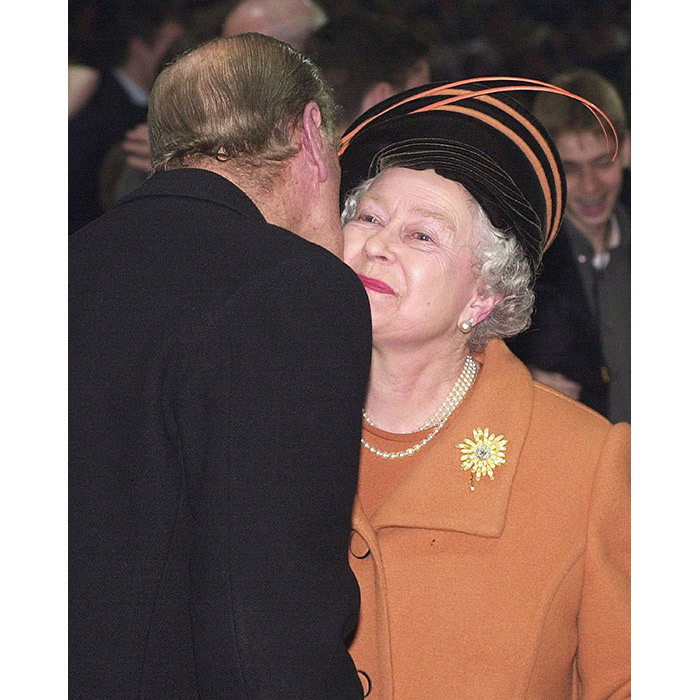 <p>Prince Philip, the Duke of Edinburgh, kisses Queen Elizabeth II during the new year's eve celebration at the Millennium Dome on 31 December, 1999.</p>