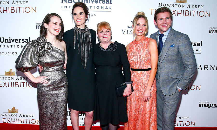 The cast of <i>Downton Abbey</i> reunited at the grand opening of a new exhibition based on the hit period drama in New York City. 