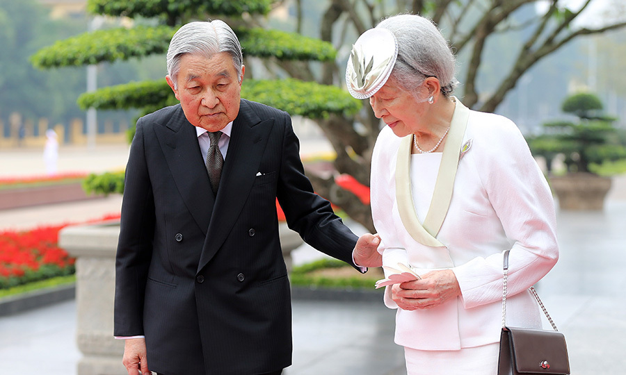 <p>NOW: Akihito became Emperor in 1989, and the royal couple's son, Crown Prince Naruhito, the eldest of their three children, became heir to the Chrysanthemum Throne. After a 30-year reign, the Emperor, seen here gently guiding his longtime love during a visit to Vietnam in March 2017, is expected to abdicate in 2019. Photo: Getty Images</p>