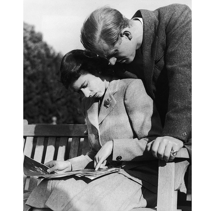 Princess Elizabeth and Prince Philip honeymooned in Hampshire, England, at the historic Broadlands house owned by Philip's uncle, Lord Mountbatten, and at Birkhill on the Balmoral estate. Here, the newlyweds are seen looking over their wedding photographs in Romsey, Hampshire. 