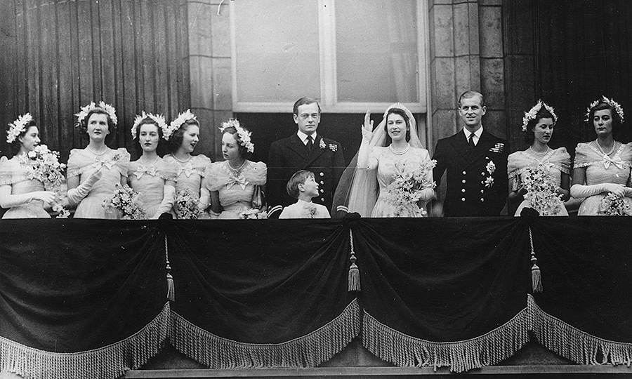 What is a royal wedding without a royal wave? Here the newlyweds gather with the wedding party on the balcony of Buckingham Palace after returning from the ceremony.