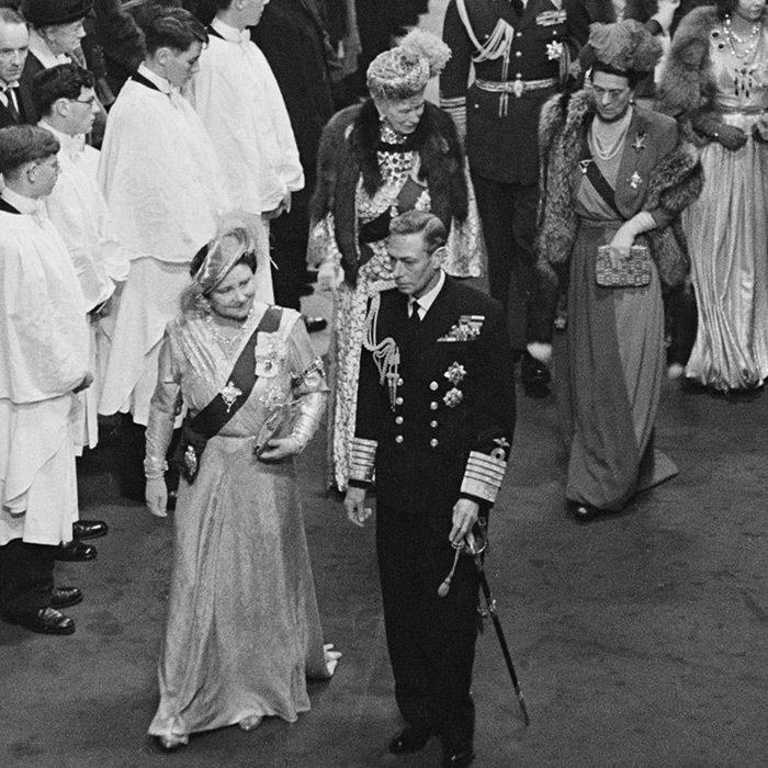 The bride's parents King George VI and Queen Elizabeth, the Queen Mother are seen making their way down the aisle of Westminster Abbey. Behind them is a regal Queen Mary, George VI's mother, who was Queen Consort from 1910 to 1936.