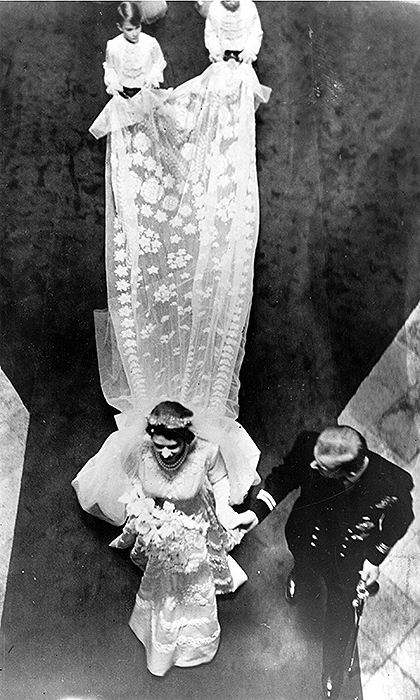 The future Queen Elizabeth II's bridal ensemble also included a 13ft star-patterned full court train attached at the shoulders, and a silk tulle veil held in place by her mother's tiara. Like the gown, the veil and train, with their bursts of stars and flowers, were inspired by Botticelli's 'Primavera'. 