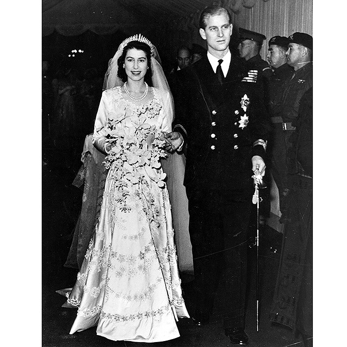 Elizabeth's embroidered wedding gown was made of ivory duchesse satin and decorated with 10,000 pearls imported from the US. The royal's bridal bouquet was made up of white orchids and a sprig of myrtle which had been snipped from a bush grown from the myrtle in Queen Victoria's wedding bouquet. The day after the nuptials, Princess Elizabeth's flowers were laid on the grave of the unknown soldier in Westminster Abbey. 