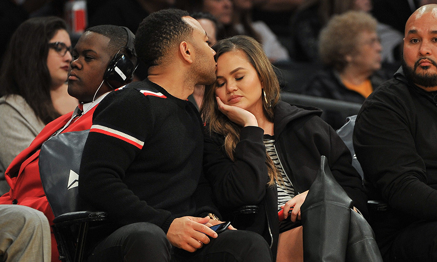 Chrissy Teigen got a sweet kiss from her husband John Legend as the couple enjoyed a date night at the Lakers game on Sunday (Nov. 19). The loved-up duo will celebrate their fifth wedding anniversary next year. 