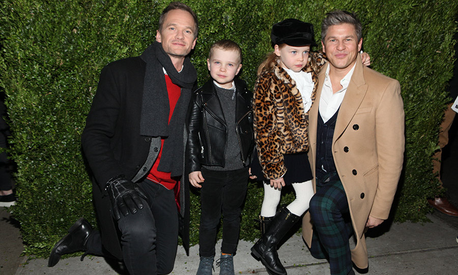 Neil Patrick Harris and David Burtka enjoyed a night out with their twins Gideon and Harper Grace at Saks Fifth Avenue & Disney 'Once Upon A Holiday' Windows Unveiling in New York. The couple's twins looked like budding style stars in their leather and cheetah-print coats. 