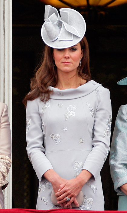 <p>Kate paired her blue cowl-neck custom Erdem dress with a gorgeous hat of the same hue by Jane Corbett, and held onto an Alexander McQueen clutch. The mother of two wore this stunning ensemble to Buckingham Palace for the annual Trooping the Colour ceremony in June 2012.