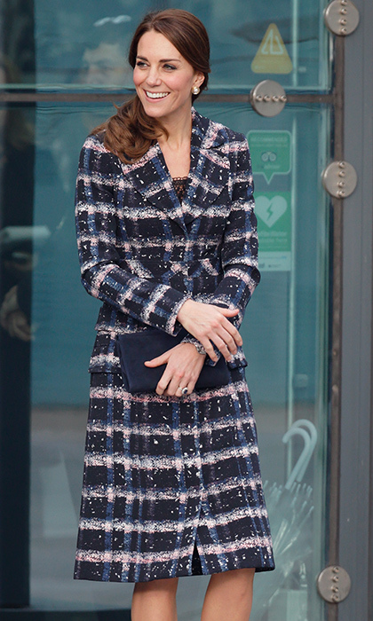 <p>How gorgeous does the Duchess look in this subdued plaid Erdem coat from the designer's Resort 2016 collection? Kate paired the coat with a cute side ponytail and simple black heels while visiting Manchester's National Football Museum in October 2016.