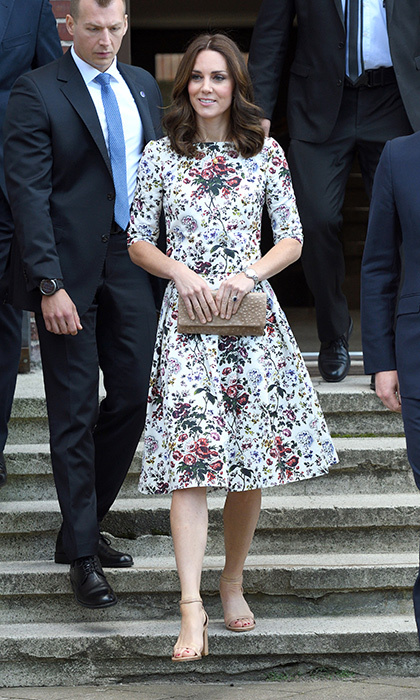 <p>Kate knows exactly how to transition her wardrobe from season-to-season! For a historical visit to the former Nazi Germany concentration camp in Poland, the Duchess wore a tasteful floral dress. The outing was part of the Royal Tour of Poland and Germany in July 2017.