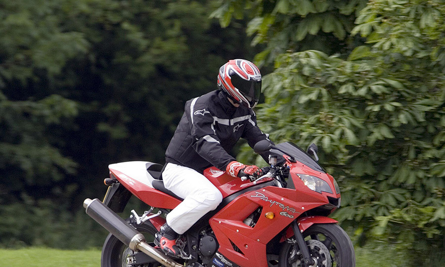 <p>Prince William arrives on his motorbike to play polo at Cirencester Park Polo Club on June 17, 2005.</p>