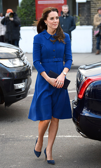 Working one of her favourite variations on her coat collection- the coatdress, the pregnant wife of Prince William stepped out in a typical royal blue belted design by Eponine London as she visited the Anna Freud Centre for Children and families on 29 January. She held a Stuart Weitzman clutch and a simple silver watch.