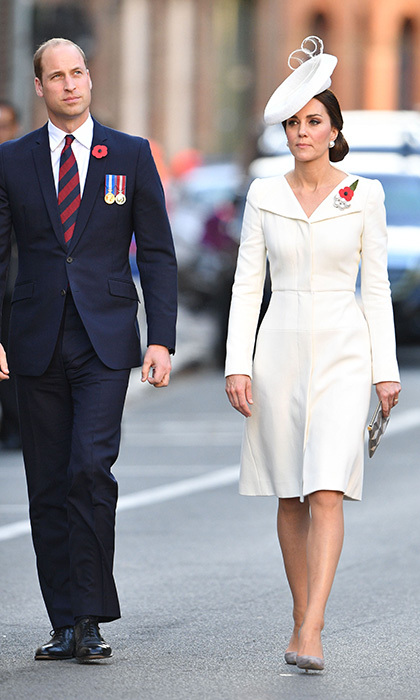 The pregnant duchess turned once again to one of her favourite designers Alexander McQueen, as she joined the Duke of Cambridge to mark 100 years since the Battle of Passchendaele on 31 July. The white coat dress included folder over lapels and a slim fit cut, with a defined waist.