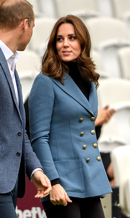 Duchess Kate showcased her chic, lady-like look in a double breasted twill blazer in periwinkle blue, by Philosophy di Lorenzo Serafini. She wore the blazer with an all-black outfit, which pepped up the look and gave it a gentle pop of colour. The mother-of-two also has the design in a ravishing red.