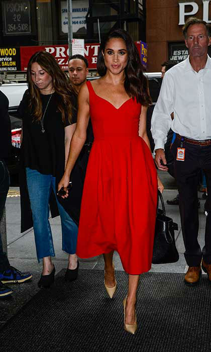 <p>Meghan Markle in New York in a stand-out red gown </p>