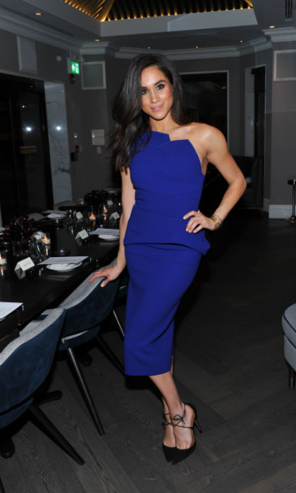 <p>Meghan looked stunning in a blue dress while out in LA</p>