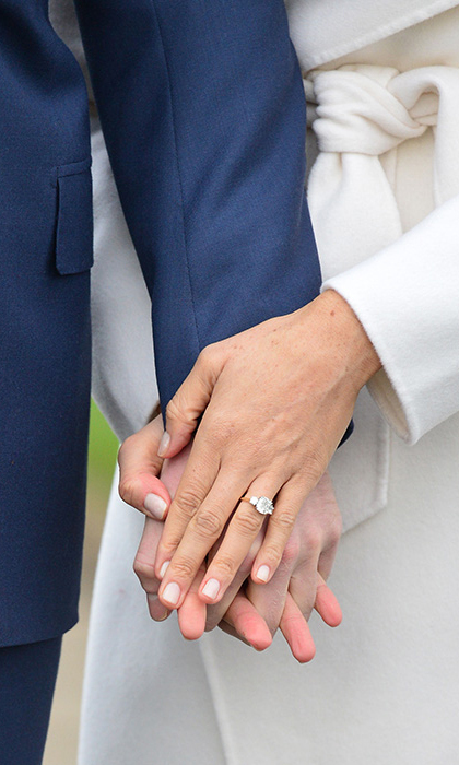 <p>Meghan's ring features a large central diamond, flanked on either side by two smaller jewels set on a gold band. The stones were specially selected by the Prince; the central dimaond is from Botswana, where the couple recently holidayed together, and the other two diamonds are from his late mother Princess Diana's personal collection. 