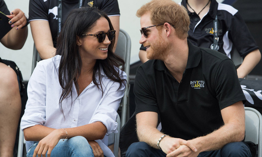<p>Prince Harry and Meghan Markle made their first official appearance together as a couple at the Invictus Games. The pair arrived hand-in-hand to watch wheelchair tennis at Nathan Phillips Square. The Suits star looked stunning in skinny jeans, a white collared shirt and black sunglasses, while Harry looked laid-back in an Invictus Games polo shirt, blue chinos and shades. The outing came after weeks of speculation that the 33-year-old would ask Meghan to join him at the sports tournament. The actress's appearance by Harry's side was seen as another sign that the duo are headed for marriage. The pair were all smiles throughout the game, and at one point Harry was pictured leaning in to closely to talk to Meghan.
