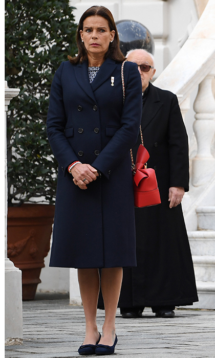 Princess Stephanie of Monaco kept things simple in red, white and blue. Grace Kelly's daughter wore a tailored coat over a navy and white dress, giving the look of pop of color with her red leather bag.