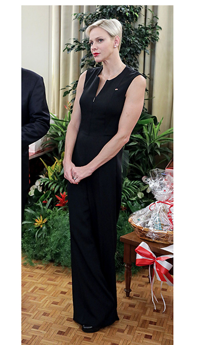 Princess Charlene rocked a wardrobe staple – the jumpsuit – as she joined husband Prince Albert for a Christmas gift-giving event at the Red Cross in Monaco on November 17. The versatile stretch silk piece is by Akris.