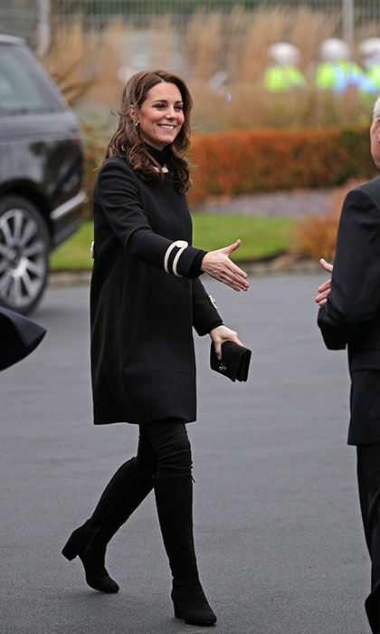 <p>For another appearance in Birmingham on Nov 22, the Duchess of Cambridge embraced dark tones. She broke out her black coat by British label Goat, pairing it with black boots and a dress underneath. She first wore the jacket back in 2014 during a visit to New York.