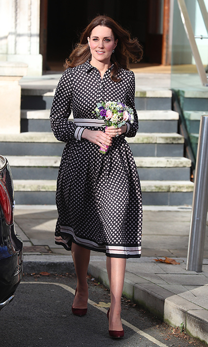 Could it have been a nod to brother-in-law Prince Harry's American bride-to-be? On November 28, the day after it was revealed L.A. native Meghan Markle will be joining the royal family, the Duchess of Cambridge wore a US designer, Kate Spade, for an official engagement to the Foundling Museum in central London. Accessorizing with Gianvito Rossi heels and a Mulberry clutch, the pregnant royal turned heads in a vibrant diamond print pleated dress set to hit stores in December. 