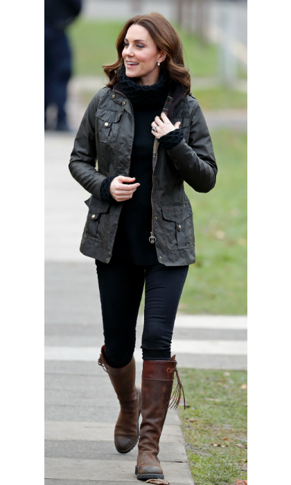 The Duchess of Cambridge continued with her official duties on Wednesday (Nov. 29) as she visited the Robin Hood Primary School in central London. The pregnant royal, who will welcome her third child in April, went for a casual, yet smart look, in comfortable black jeans, and a cozy roll neck jumper by Temperley London. She also wore a familiar coat, her Barbour Defence Jacket and beloved  Penelope Chilvers Long Tassel Boots. 