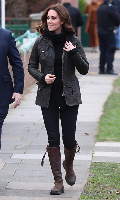 The Duchess of Cambridge went for a casual country look on November 29 as she visited the Robin Hood Primary School in central London. The pregnant royal, who will welcome her third child in April, was cozy and comfy in black jeans, a Barbour jacket and chunky turtleneck sweater by Temperley London. The Duchess finished the look with her trusty flat brown boots by Penelope Chilvers.