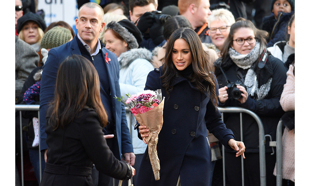 Harry and Meghan split up to chat with people lining both sides of the route, accepting everything from bars of chocolate to cards of congratulations. The crowds were a sea of mobile phones, as people strained to capture the royal rite of passage for the TV star.