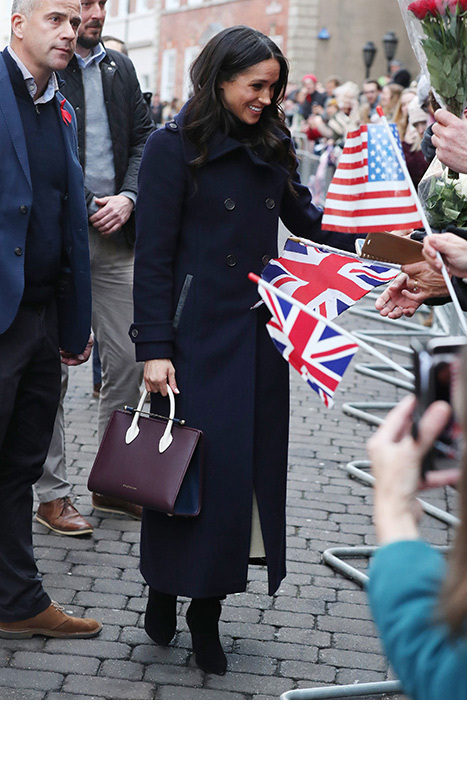 Some members of the public waved American Stars and Stripes, alongside the Union flag, to make LA-born Meghan feel more at home.