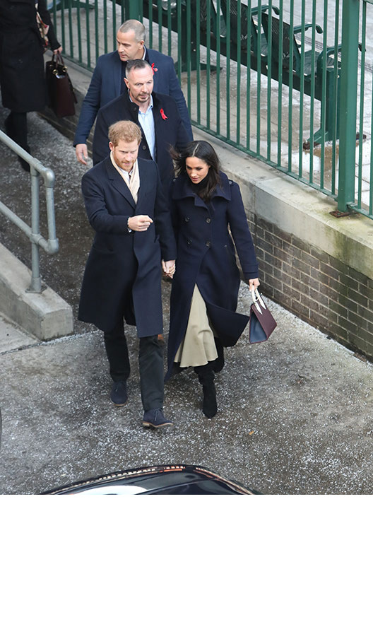 Harry played a very protective role, holding on to his future wife as they made their way to the National Justice Museum.