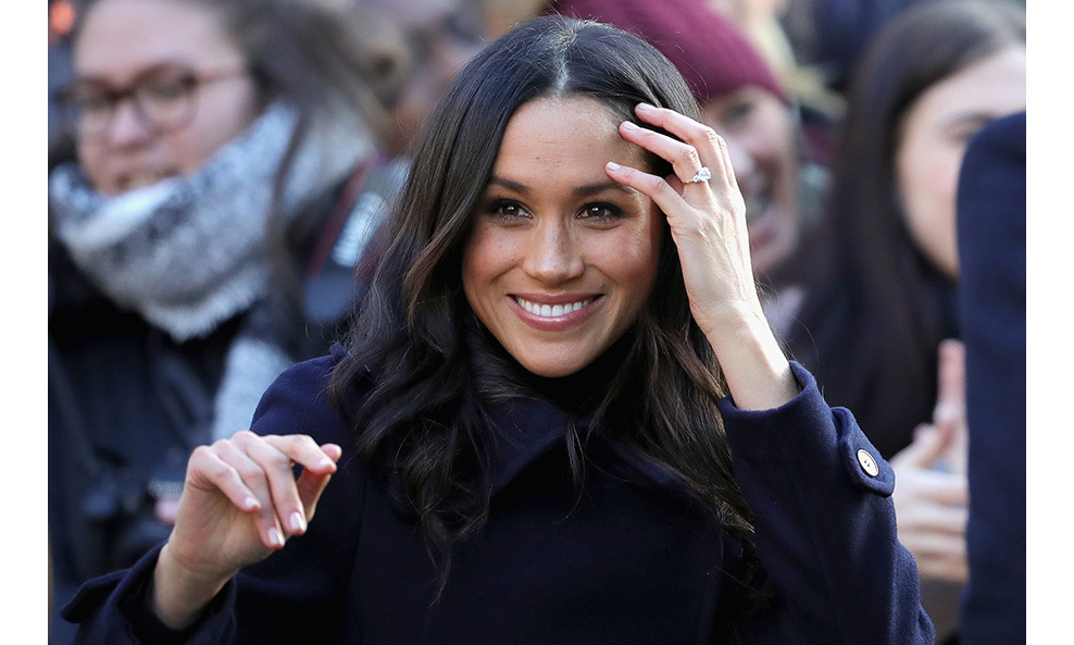 "Natural beauty Meghan looked picture perfect on her first outing. The 36-year-old actress waved to crowds and showed off <a href=""/royalty/02017112740396/prince-harry-meghan-markle-first-look-engagement-ring/""><strong>her stunning engagement ring</strong></a>. The trilogy ring features a large central diamond, flanked on either side by two smaller jewels set on a gold band.
