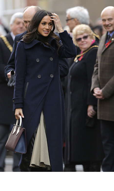 Meghan showed off her sartorial prowess, wrapping up in a navy coat by Mackage. Underneath, Meghan wore a black roll-neck and cream skirt combo, teamed with boots and a burgundy handbag. She wore her long raven hair loosely around her shoulders, and kept her make-up to a minimum.