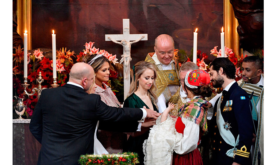 Princess Sofia's sister Sara Hellqvist, centre, had a prominent role as godmother. Here she is at the altar with godfather Thomas de Toledo Sommerlath, godmother Princess Madeleine, Bishop Johan Dalman, Archbishop Anders Wejryd and Gabriel's parents Sofia and Carl Philip. 