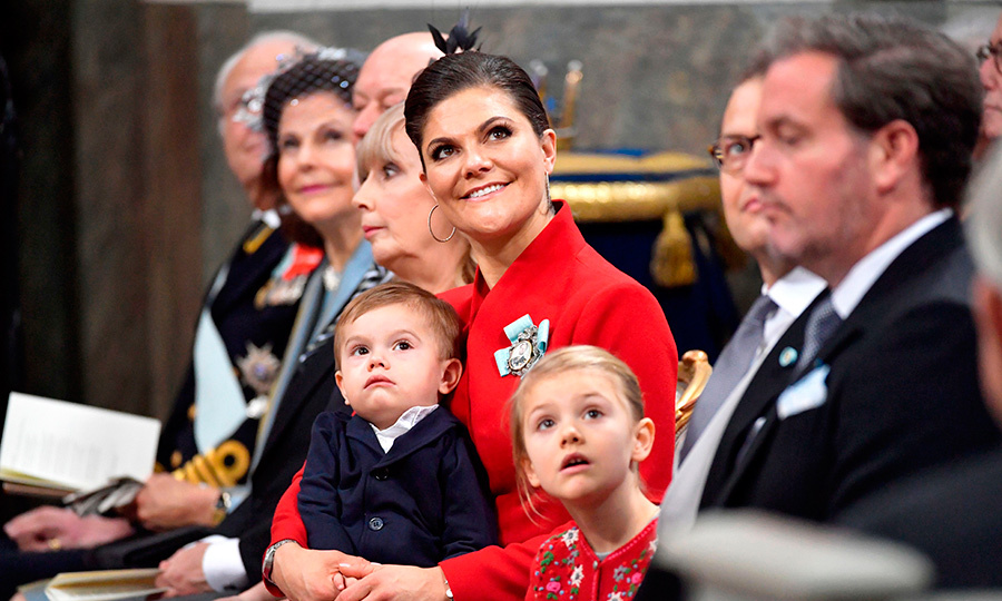 Future queen Crown Princess Victoria was seated front row with her 21-month-old son Prince Oscar in her arms, and alongside little Princess Estelle. Also in the first pew were the king and queen, Prince Daniel and Chris O'Neill.