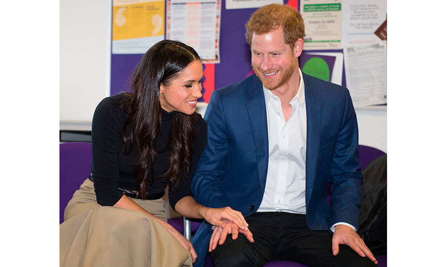 The happy couple shared a loving moment while taking part in a discussion at Nottingham Academy. 