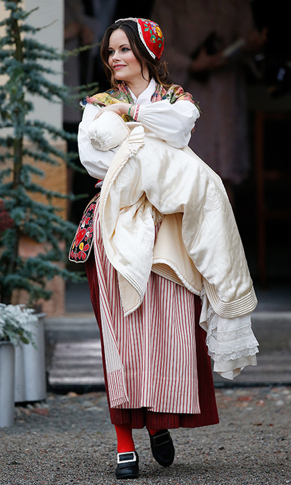 Princess Sofia is seen in her traditional dress – including buckled shoes and embroidered cap – as she carries her son. Prince Gabriel's antique lace christening gown was first worn by the king's father Prince Gustaf Adolf in 1906. In recent years, the beautiful robe has also been the centerpiece of christenings for not just Gabriel's brother Alexander, but also Crown Princess Victoria and Prince Daniel's children Estelle and Oscar, and Princess Madeleine and Chris O'Neill's children Leonore and Nicolas.