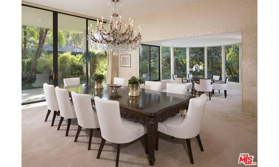 Adam and Behati will be able to entertain a number of guests at dinner parties; their new home has a huge dining room with two dining tables that could seat up to 15. The room is decorated in neutral tones with large windows and glass doors that lead out onto the expansive gardens.