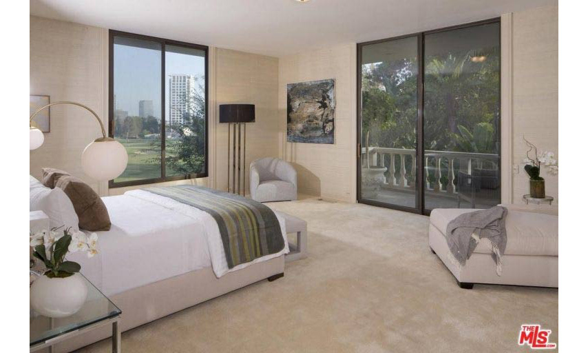 There are five bedrooms in the spacious home, including two master bedrooms. This room has its own private balcony and views out across the garden along with the Century City skyline and Los Angeles Country Club. The couple will easily be able to put their own stamp on the property, as it is currently neutrally decorated with plenty of potential.
