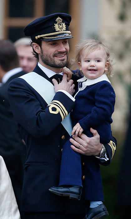 <p>Prince Alexander got dressed up for his younger brother Prince Gabriel's christening on December 1, 2017. The little prince showed off his toothy smile as he was held by his father Prince Carl Philip. Just last year, the Swedish royals attended his own baptism.</p>