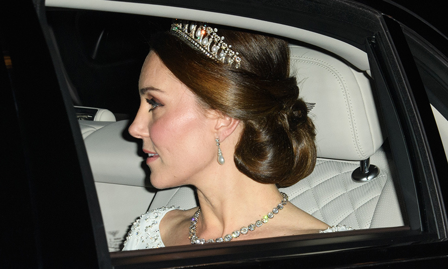 The Duchess of Cambridge arrived at Buckingham Palace's annual Diplomatic Reception December 5, wearing a stunning white jewelled gown and diamond collet necklace from Her Majesty's jewel vault.